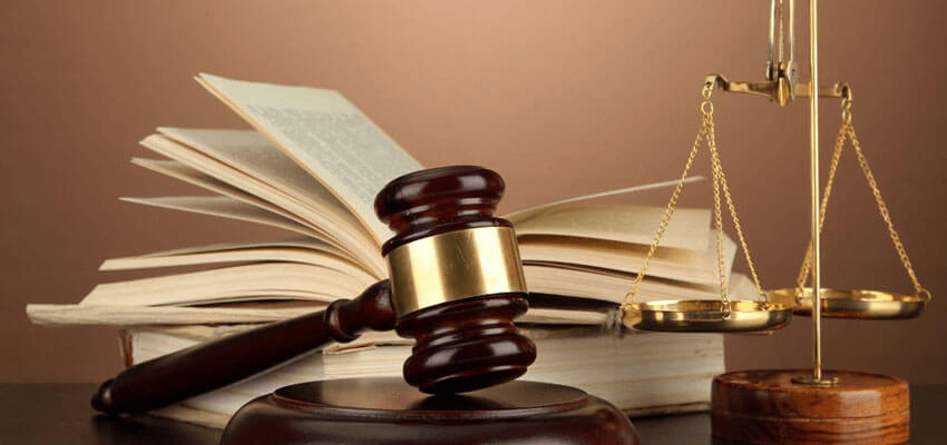 gavel, book and scale representing law