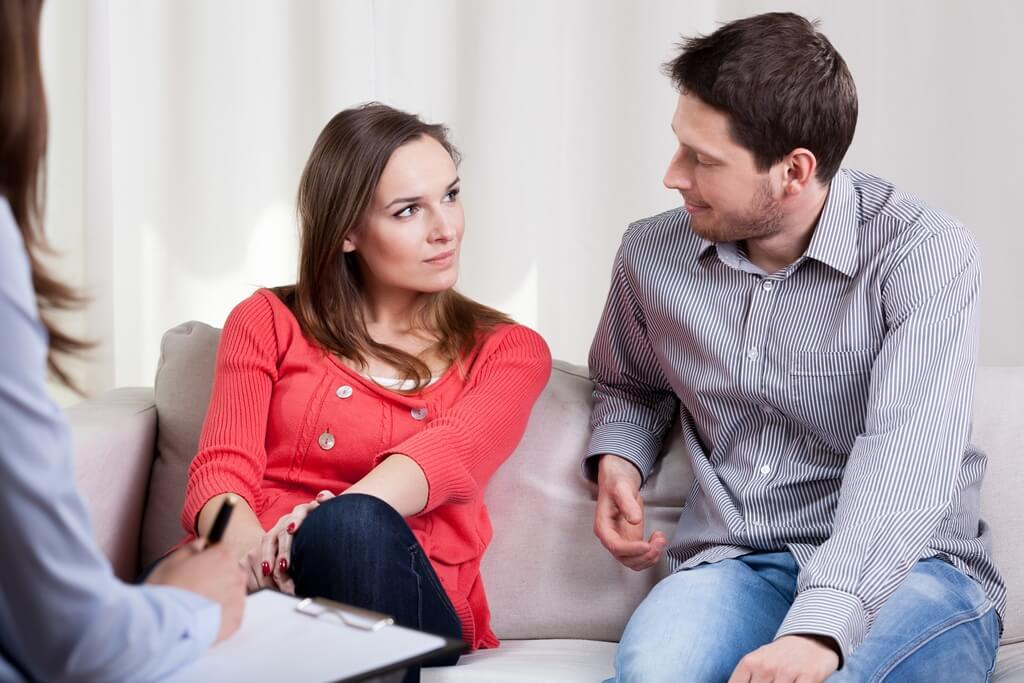 couple looking at each other on legal consultation
