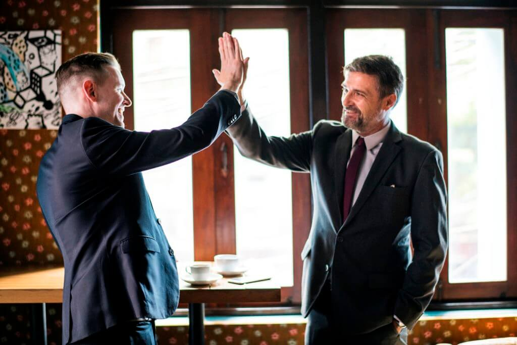 2 lawyers high five